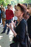 Berlin, Germany - 23.05.2016<br /> <br /> Ulla Jepke, (Member of the Bundestag, Left Party) at the press conference after the eviction of the Memorial to the Sinti and Roma Victims of National Socialism in Berlin's government district. Some Roma and Sinti, who kicked out of the memorial few hours before by the police hold a press conference. They contradicted reports that they finish their protest for the right to stay voluntarily and report that some of them were injured during the police operation. Also Uwe Neumaerker, the director of the Foundation Memorial to the Murdered Jews of Europe, as well as the politicians Fabio Reinhardt (Pirate Party) &amp; Ulla Jelpke (Left Party) join the new conference. Despite critical discussions the Roma Stefan Asanovski &amp; Isen Asanovski embraced the Foundation Director Uwe Neumaerker and asked him for more help. Police forces stood at the edge of the press conference, apparently to prevent a re-enter the Memorial through the protesting Roma.<br /> <br /> Ulla Jepke, MdB Linkspartei bei der Pressekonferenz nach der Raeumung des Denkmal f&uuml;r die im Nationalsozialismus ermordeten Sinti &amp; Roma im Berliner-Regierungsviertel. Einige der in der Nacht von der Polizei geraeumten Sinti &amp; Roma geben eine PK. Sie widersprachen Berichten, wonach sie ihren Bleiberechtprotest am Denkmal freiwillig beendet haetten und berichteten, davon dass sie teilweise bei dem Polizeieinsatz verletzt wurden. Auch Uwe Neumaerker, der Direktor der Stiftung Denkmal f&uuml;r die ermordeten Juden Europas, sowie die Politiker Fabio Reinhardt (MdA Berlin, Piraten) &amp; Ulla Jelpke (MdB, Linke) kamen zur PK vor dem Mahnmal. Trotz kritischer Diskussionen umarmten die Roma Stefan Asanovski &amp; Isen Asanovski den Stiftungdirektor Uwe Neumaerker und baten ihn um weitere Hilfe. Polizeikraefte standen am Rand der PK, offenbar um ein erneutes betreten des Denkmals durch die protestierenden Roma zu verhindern. <br /> <br /> Photo: Bjoern Kietzmann