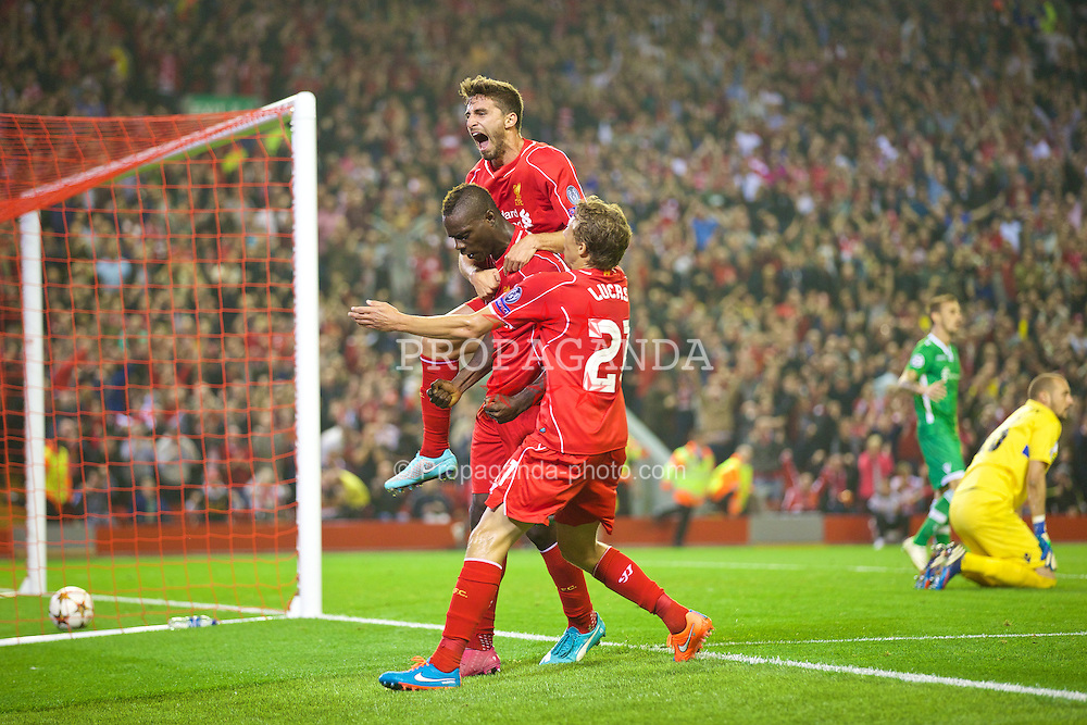 LIVERPOOL, ENGLAND - Tuesday, September 16, 2014: Liverpool's Mario Balotelli celebrates scoring the first goal against PFC Ludogorets Razgrad with team-mates Fabio Borini and Lucas Leiva during the UEFA Champions League Group B match at Anfield. (Pic by David Rawcliffe/Propaganda)