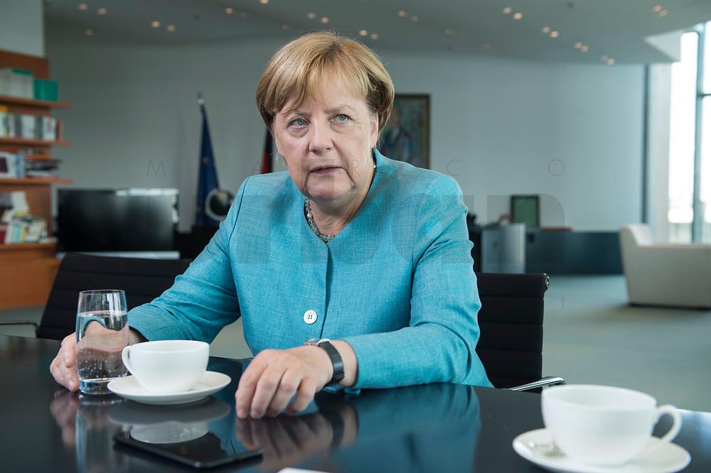23 AUG 2017, BERLIN/GERMANY:<br /> Angela Merkel, CDU, Bundeskanzlerin, waehrend einem Interview, in Ihrem Buero, Bundeskanzleramt<br /> IMAGE: 20170823-02-005<br /> KEYWORDS: Büro