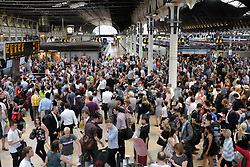 © Licensed to London News Pictures. 25/07/2014. London, UK. Commuters at Paddington Rail station are unable to travel because of disruption to signals between London and Reading caused by a thunderstorm. Reduced and delayed services are leaving Paddington and trains are full to capacity with many travellers unable to board.  lPhoto credit : Richard Isaac/LNP
