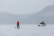 Fishing from shore and from boats, along with paddleboarding are popular activities on Resurrection Bay near Seward, Alaska.