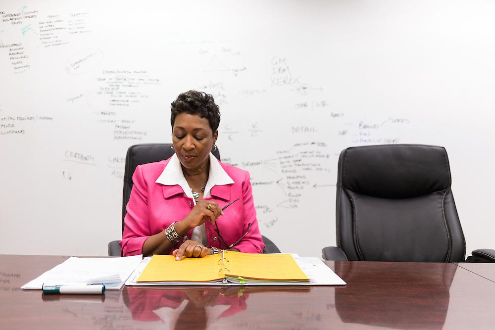female executive financial advisor preparing for a client meeting