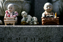 SOUTH KOREA MASAN 28OCT07 - Miniature Buddhas placed at the feet of a sculpture at a Confucian temple in Masan, south Korea...jre/Photo by Jiri Rezac..© Jiri Rezac 2007..Contact: +44 (0) 7050 110 417.Mobile:  +44 (0) 7801 337 683.Office:  +44 (0) 20 8968 9635..Email:   jiri@jirirezac.com.Web:    www.jirirezac.com..© All images Jiri Rezac 2007 - All rights reserved.