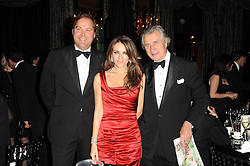 Left to right, the HON.HARRY HERBERT, ELIZABETH HURLEY and ARNAUD BAMBERGER Executive Chairman of Cartier UK at the 20th annual Cartier Racing Awards - the most prestigious award ceremony within European horseracing, held at The Dorchester Hotel, Park Lane, London on 16th November 2010.