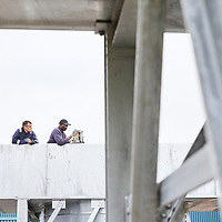 A photograph of two employees collaborating at a british manufacturing firm working on a large metal structure