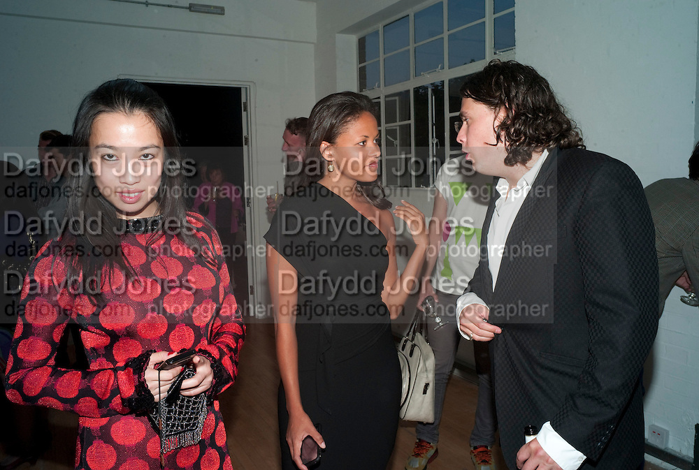"YI ZHOU; RACHEL BARRETT; ADAM WAYMOUTH , Video artist Yi Zhou  first solo show ""I am your Simulacrum"".Exhibition opening at 20 Hoxton Square Projects. Hoxton Sq. London. 1 September 2010.  -DO NOT ARCHIVE-© Copyright Photograph by Dafydd Jones. 248 Clapham Rd. London SW9 0PZ. Tel 0207 820 0771. www.dafjones.com."