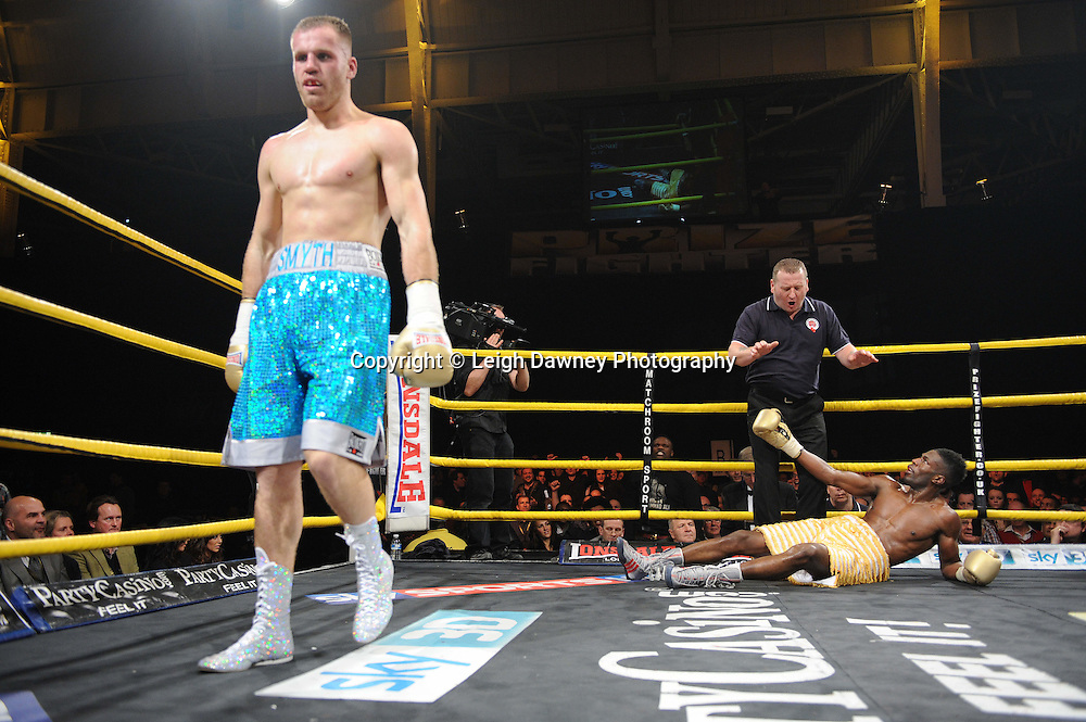 Menay Edwards (yellow shorts) defeats Joe Smyth at Prizefighter The Light Heavyweights II, Olympia, London on 29th January 2011. Photo credit © Leigh Dawney.