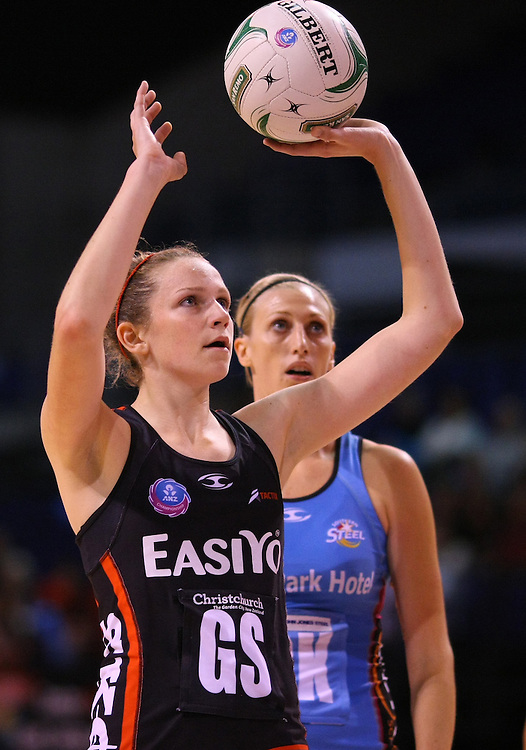 Tactix's Jo Harten shoots for goal as Southern Steel's Demelza McCloud looks on in the ANZ Netball Championship, CBS Arena, Christchurch, New Zealand, Sunday, April 15, 2012. Credit:SNPA / Dianne Manson
