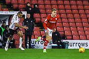 Brad Potts of Barnsley (20) gets past Darren Pratley of Charlton Athletic (15) during the EFL Sky Bet League 1 match between Barnsley and Charlton Athletic at Oakwell, Barnsley, England on 29 December 2018.