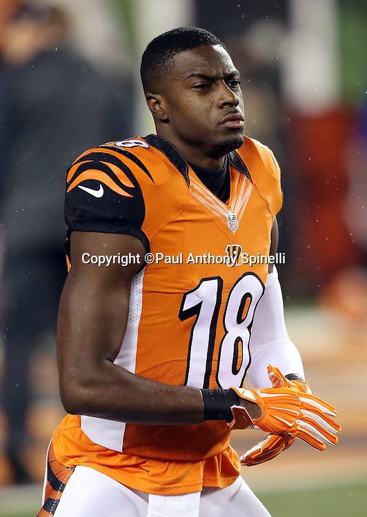 Cincinnati Bengals wide receiver A.J. Green (18) stretches while warming up before the 2015 week 10 regular season NFL football game against the Houston Texans on Monday, Nov. 16, 2015 in Cincinnati. The Texans won the game 10-6. (©Paul Anthony Spinelli)