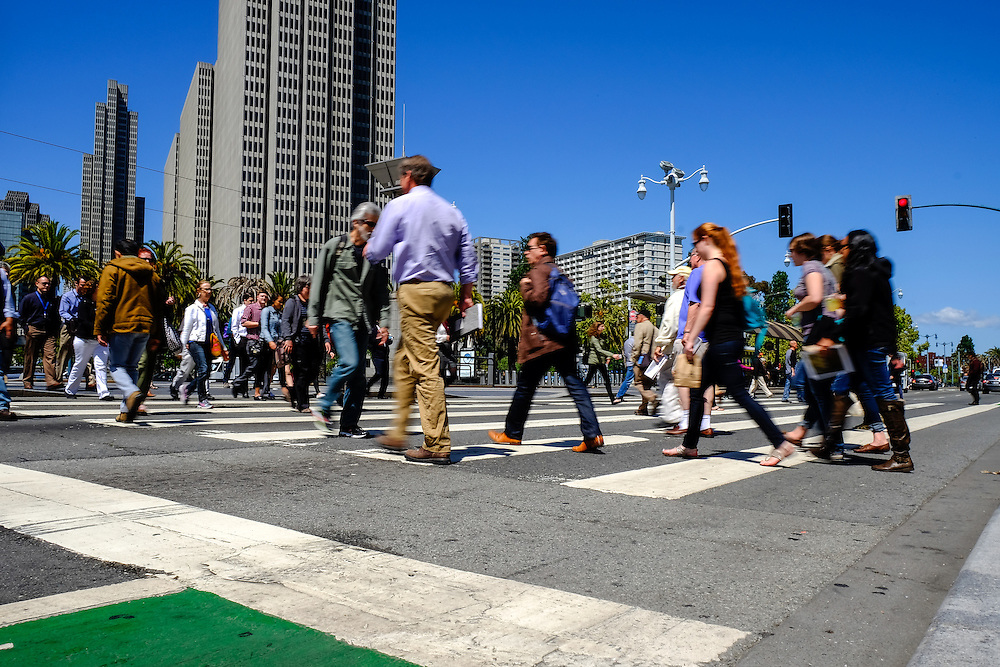Pedestrians crossing the street in front of San Francisco's Ferry Building | May 6, 2014