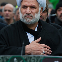 LONDON, ENGLAND - DECEMBER 27:  A Shia Muslim cleric take part in the Ashura procession from Marble Arch to Holland Park Mosque on December 27, 2009 in London, England. Ashura is a 10 day period of mourning for Imam Hussein, the seven-century grandson of Prophet Mohammad who was killed in a battle in Karbala in Iraq, in 680 AD.  (Photo by Marco Secchi/Getty Images)