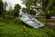 'Indo Tibetan Boarder Police (ITBP) A Force To Be Reckon With' sign which has been blown over in a recent storm in Guwahati, Assam, India. (photo by Andrew Aitchison / In pictures via Getty Images)