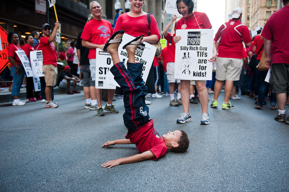 CPS students and parents join the Chicago Teachers Union to rally outside CPS Headquarters on September 11, 2012.