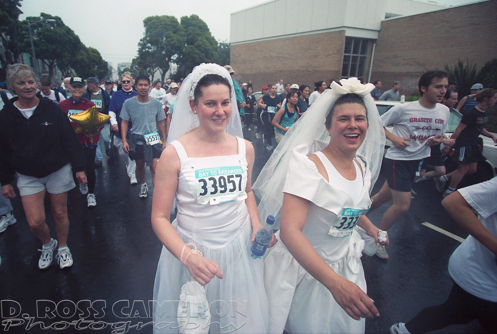 A pair of unidentified runaway brides make their way west on Fell Street at the 91st running of the Bay to Breakers 12K race, Sunday, May 19, 2002 in San Francisco. (Photo by D. Ross Cameron)