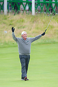Mark Calcavecchia celebrates sinking a putt on the 18th green during the final round of the Rolex Senior Golf Open at St Andrews, West Sands, Scotland on 29 July 2018. Picture by Malcolm Mackenzie.
