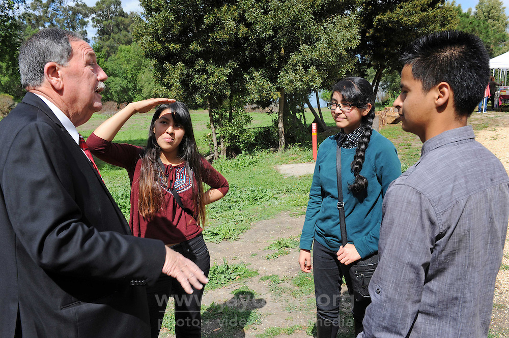 At the opening on Sunday, April 24th of the Acosta Plaza Recreation Area in east Salinas, CA, Youth for Change members talk with Mayor Joe Gunter about the project.