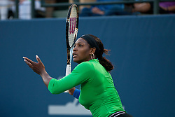 July 26, 2011; Stanford, CA, USA;  Serena Williams (USA) returns the ball against Anastasia Rodionova (AUS), not pictured, during the first round of the Bank of the West Classic women's tennis tournament at the Taube Family Tennis Stadium. Williams defeated Rodionova 6-0, 6-0.