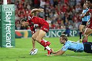 Quade Cooper goes over to score a try. Queensland Reds v NSW Waratahs. Investec Super Rugby Round 10 Match, 24 April 2011. Suncorp Stadium, Brisbane, Australia. Reds won 19-15. Photo: Clay Cross / photosport.co.nz