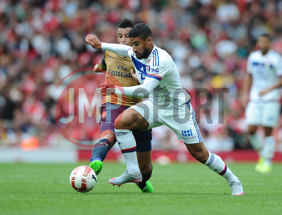 Nabil Fekir of Lyon battles for the ball with Francis Coquelin of Arsenal   - Mandatory by-line: Joe Meredith/JMP - 25/07/2015 - SPORT - FOOTBALL - London,England - Emirates Stadium - Arsenal v Lyon - Emirates Cup
