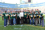 Green Bay Packers legend Bart Starr takes a picture with former players before the game against the San Francisco 49ers during an NFL football game in Green Bay, Wisconsin Saturday, Sept. 9, 2012. (AP Photo/Tom Hauck)