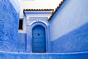 CHEFCHAOUEN, MOROCCO - 28th MARCH 2014 - Blue doorway architecture in the Chefchaouen Medina - the blue city - Rif Mountains, Northern Morocco.
