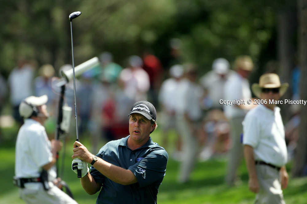 U.S. golfer Phil Mickelson watches his chip shot from the rough on the 8th fairway during first round play at The International Thursday August 10, 2006 at Castle Pines Golf Club. Mickelson would go on to par the hole but had a rough outing Thursday finishing at +1. The event started Thursday and continues through Sunday at Castle Pines Golf Club..(MARC PISCOTTY/ © 2006)