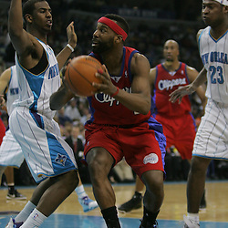 Jan 13, 2010; New Orleans, LA, USA; Los Angeles Clippers guard Baron Davis (1) drives in against New Orleans Hornets guard Chris Paul (3) during the second quarter at the New Orleans Arena. Mandatory Credit: Derick E. Hingle-US PRESSWIRE