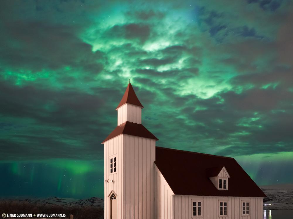 Northern lights at church Glæsibæjarkirkja.