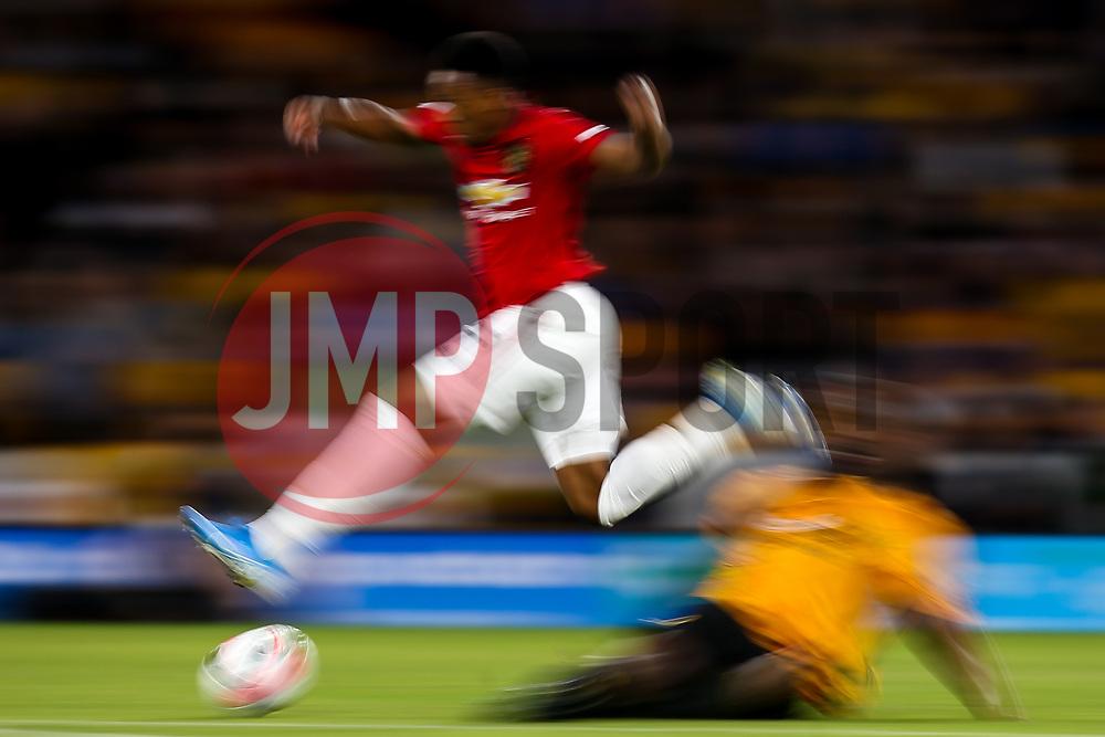 Raul Jimenez of Wolverhampton Wanderers takes on Willy Boly of Wolverhampton Wanderers - Mandatory by-line: Robbie Stephenson/JMP - 19/08/2019 - FOOTBALL - Molineux - Wolverhampton, England - Wolverhampton Wanderers v Manchester United - Premier League