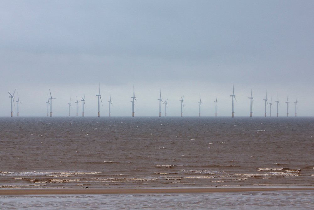 The Lincs Wind Farm breaking through the rain clouds. It is a 270MW offshore wind farm 8 kilometres (5.0mi) off Skegness Lincolnshire, on the east coast of England in the North Sea. It cost over £1billion to build including electrical transmission links and was completed in 2013. Skegness, Lincolnshire, United Kingdom.  (photo by Andrew Aitchison / In pictures via Getty Images)