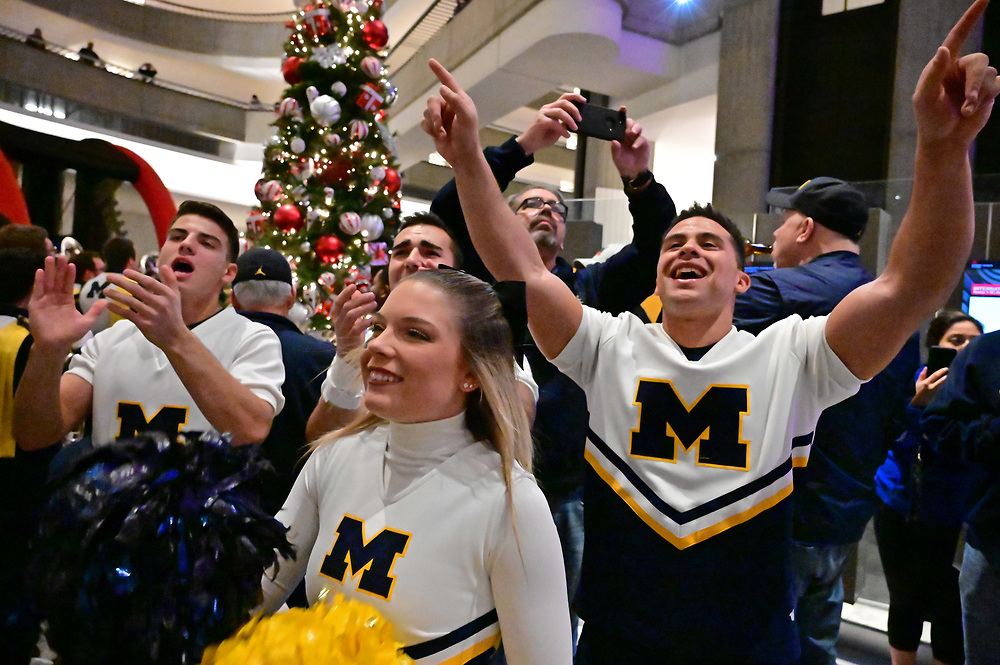 University of Michigan cheerleaders participate in a football FanFest at the Marriott Marquis during preparations for the Chick-fil-A Peach Bowl, December 28, 2018, in Atlanta. Michigan will face Florida in the Chick-fil-A Peach Bowl at Mercedes-Benz Stadium on December 29, 2018. (David Tulis via Abell Images for Chick-fil-A Peach Bowl)