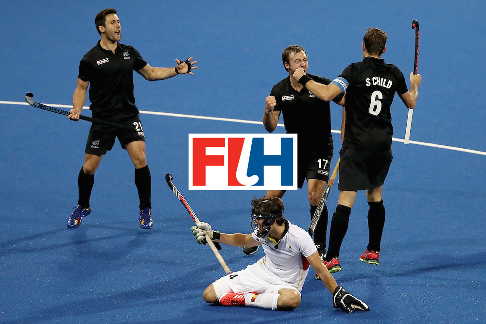 RIO DE JANEIRO, BRAZIL - AUGUST 12:  Kane Russell #21, Nic Woods #17, Simon Child #6 of New Zealand react to a goal as Arthur van Doren #4 of Belgium looks on during a Men's Preliminary Pool B match on Day 7 of the Rio 2016 Olympic Games at the Olympic Hockey Centre on August 12, 2016 in Rio de Janeiro, Brazil.  (Photo by Sean M. Haffey/Getty Images)