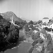 06/03/1957<br /> 03/06/1957<br /> 06 March 1957<br /> View of river and basilica at Lourdes, France.