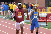 Eric Allen Jr. of Southern California (left) defeats Seth Holloway of UCLA to win the 200m in 20.80 during an NCAA college dual meet in Los Angeles, Sunday, April 28, 2019.
