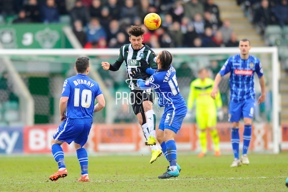 Plymouth Argyle's Graham Carey gets to the ball before Notts County's Curtis Thompson during the Sky Bet League 2 match between Plymouth Argyle and Notts County at Home Park, Plymouth, England on 27 February 2016. Photo by Graham Hunt.