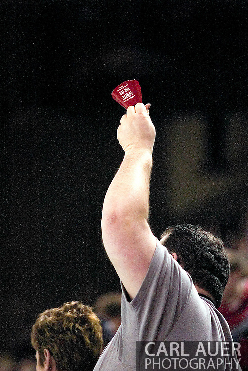 "17 February, 2006 - Anchorage, AK:  A fan rings a Aces ""Ignite the Ice"" cowbell during the Alaska Aces 5-1 victory over the visiting Long Beach IceDogs at Sullivan Arena."
