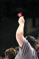 """17 February, 2006 - Anchorage, AK:  A fan rings a Aces """"Ignite the Ice"""" cowbell during the Alaska Aces 5-1 victory over the visiting Long Beach IceDogs at Sullivan Arena."""