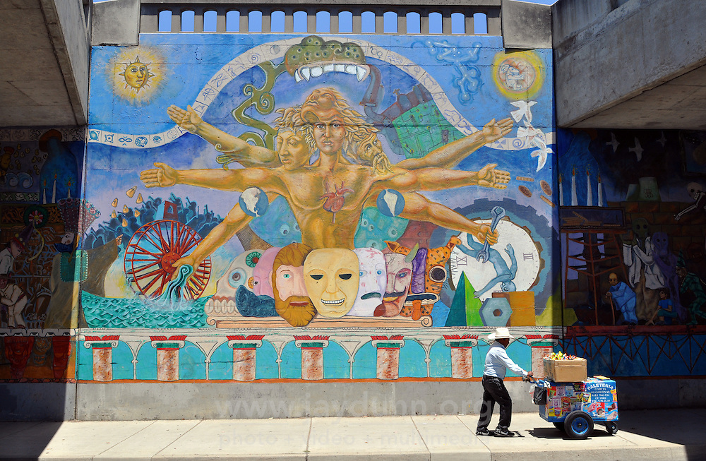 A perfect confluence of light & opportunity on Monday beneath the Hwy 101 bridge along East Alisal Street in Salinas. The multicolored murals on both sides of this busy underpass reflect proud traditions and themes of Salinas' ethnic heritage.