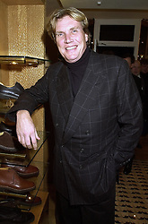 Jeweller THEO FENNELL at a party in London on 25th October 2000.OIH 6