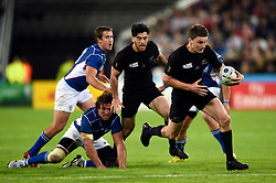 Beauden Barrett of New Zealand takes on the Namibia defence - Mandatory byline: Patrick Khachfe/JMP - 07966 386802 - 24/09/2015 - RUGBY UNION - The Stadium, Queen Elizabeth Olympic Park - London, England - New Zealand v Namibia - Rugby World Cup 2015 Pool C.