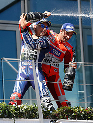 14.08.2016, Red Bull Ring, Spielberg, AUT, MotoGP, NeroGiardini Grand Prix von Oesterreich, Rennen, im Bild Jorge Lorenzo (ESP/ Movistar Yamaha MotoGP) und Andrea Iannone (ITA/ Ducati Team) // Jorge Lorenzo (ESP/ Movistar Yamaha MotoGP) and Andrea Iannone (ITA/ Ducati Team) celebrating after the race of the Austrian MotoGP Grand Prix at the Red Bull Ring in Spielberg, Austria on 2016/08/14, EXPA Pictures © 2016, PhotoCredit: EXPA/ Erwin Scheriau