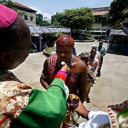 Freddie Michael, a Masai dressed in traditional attire and red ochre on his head, takes communion at the Anglican cathedral in Zanzibar. Leaders of the world's 77 million Anglicans, in Tanzania for a closed, six-day conference, traveled by boat from the mainland for a Solemn Eucharist in the only Anglican cathedral on this predominantly Muslim archipelago on the Indian Ocean.