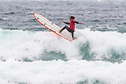 Edouard Delpero carves a radical turn 'off the lip' during the Boardmasters Longboard Pro at Fistral Beach, Newquay, Cornwall, United Kingdom on 10 August 2019.