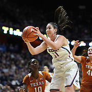 UNCASVILLE, CONNECTICUT- DECEMBER 4: Natalie Butler #51 of the Connecticut Huskies rebounds during the UConn Huskies Vs Texas Longhorns, NCAA Women's Basketball game in the Jimmy V Classic on December 4th, 2016 at the Mohegan Sun Arena, Uncasville, Connecticut. (Photo by Tim Clayton/Corbis via Getty Images)