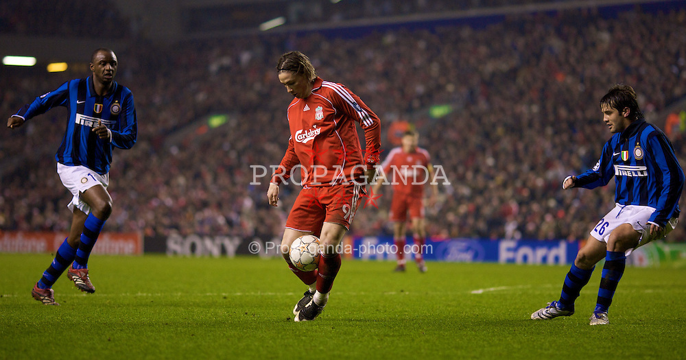 LIVERPOOL, ENGLAND - Tuesday, February 19, 2008: Liverpool's Fernando Torres and FC Internazionale Milano's Cristian Chivu during the UEFA Champions League First Knockout Round 1st Leg match at Anfield. (Photo by David Rawcliffe/Propaganda)