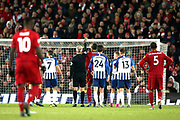 Referee Martin Atkinson shows Liverpool goalkeeper Alisson Becker (1) the red card during the Premier League match between Liverpool and Brighton and Hove Albion at Anfield, Liverpool, England on 30 November 2019.