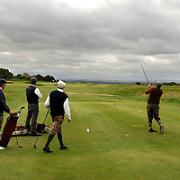 The PGA World Hickory Golf Open is being held at Gullane Golf Club on Thursday and Friday, 24th and 25th September 2009 featuring professional golf champions and amateurs in traditional 1930s period costume with six pre-1936 hickory shafted clubs in pencil golf bags...Picture shows hickory golfers on the course.