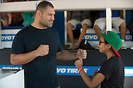 HOUSTON, TX - OCTOBER 3:  Cain Velasquez faces off with a fan during the UFC 192 fan village at the Toyota Center on October 3, 2015 in Houston, Texas. (Photo by Cooper Neill/Zuffa LLC/Zuffa LLC via Getty Images) *** Local Caption *** Cain Velasquez