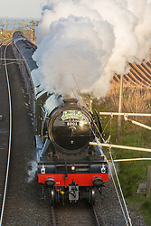 The Flying Scotsman returns to Scotland as it passes over the border from England just north of Berwick Upon Tweed